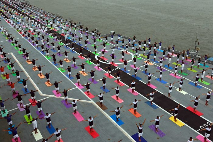 Yoga was performed on the flight deck of decommissioned Indian Navy aircraft carrier INS Viraat.