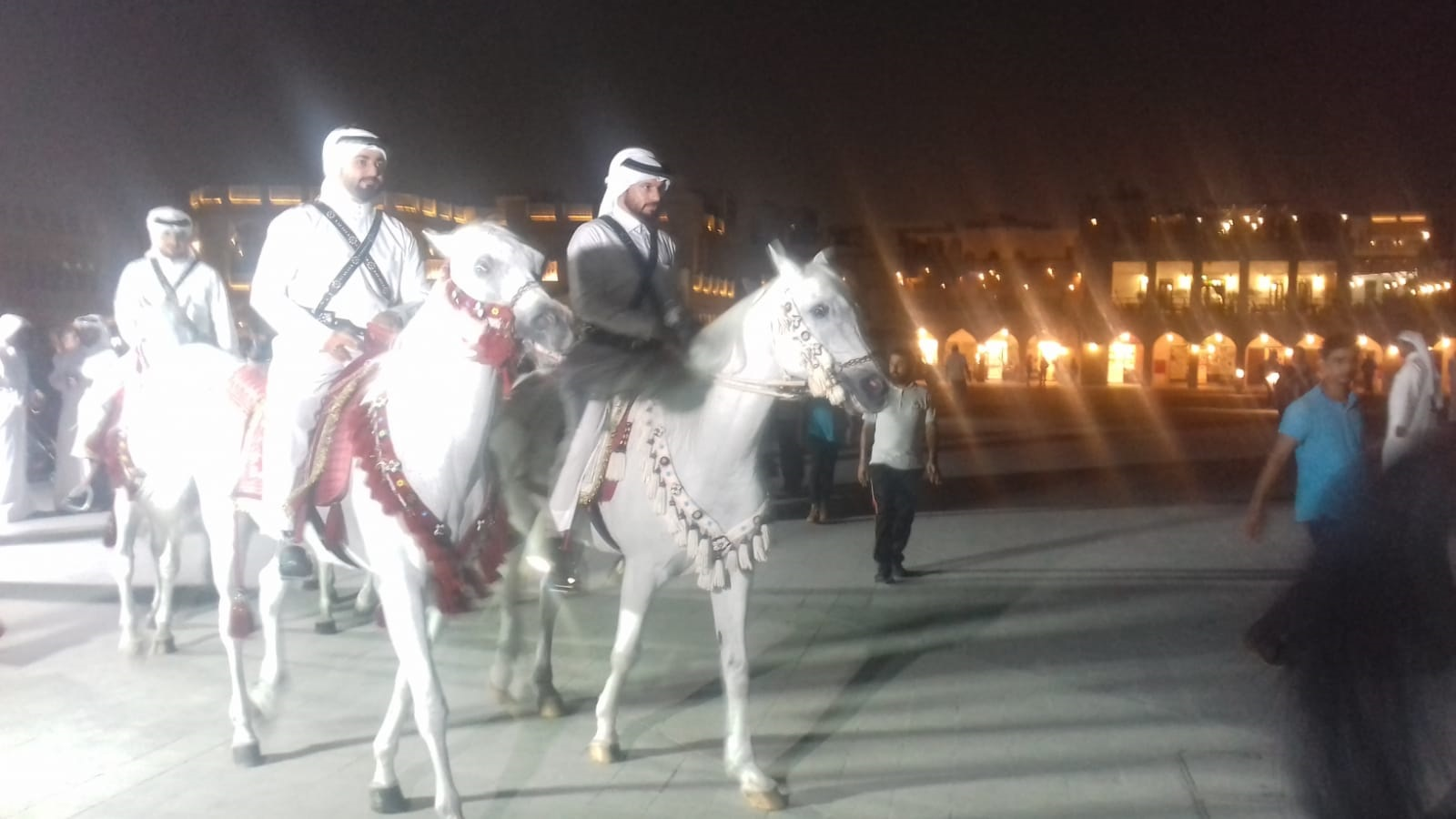 A horse parade circling the ground overlooking the Msheireb building at Souq Waqif before the unveiling of the FIFA 2022 emblem.